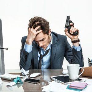 Employee at desk with handgun.