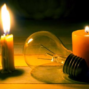 Candle and loose light bulb