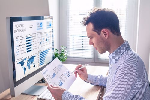 A man observes a data sheet while working in a remote environment.